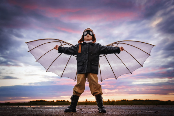 Boy,With,Wings,At,Sunset,Imagines,Himself,A,Pilot,And